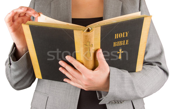 Woman in business suit is reading a holy bible Stock photo © michaklootwijk