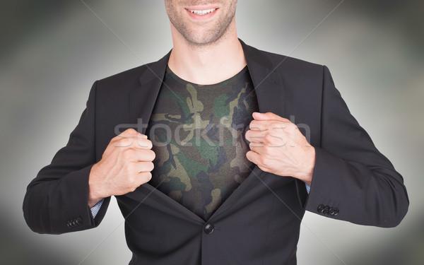 Businessman opening suit to reveal shirt Stock photo © michaklootwijk