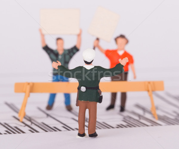 Tiny person demonstrating on a graph, selective focus Stock photo © michaklootwijk