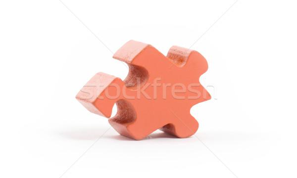Closeup of big orange jigsaw puzzle piece Stock photo © michaklootwijk