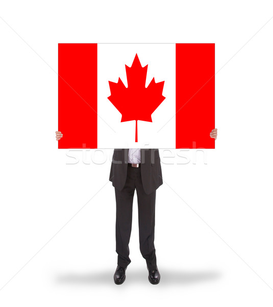 Smiling businessman holding a big card, flag of Canada Stock photo © michaklootwijk