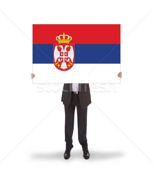 Businessman holding a big card, flag of Serbia Stock photo © michaklootwijk