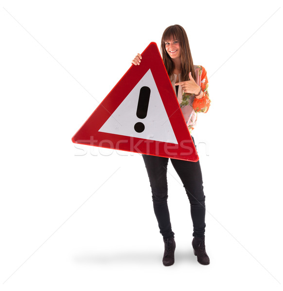 Concept of caution - Woman standing with caution sign Stock photo © michaklootwijk