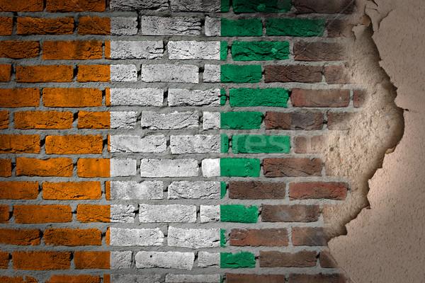 Ciemne murem gipsu Wybrzeże Kości Słoniowej tekstury banderą Zdjęcia stock © michaklootwijk