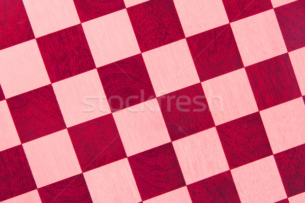 Eski ahşap satranç tahtası yalıtılmış kırmızı Stok fotoğraf © michaklootwijk
