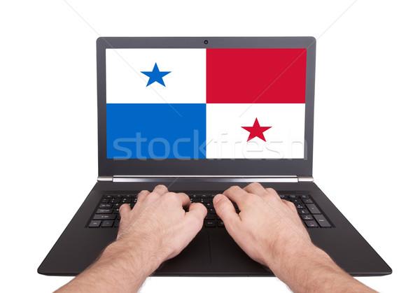 Kezek dolgozik laptop Panama mutat képernyő Stock fotó © michaklootwijk