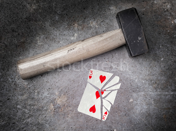 Hammer with a broken card, three of hearts Stock photo © michaklootwijk
