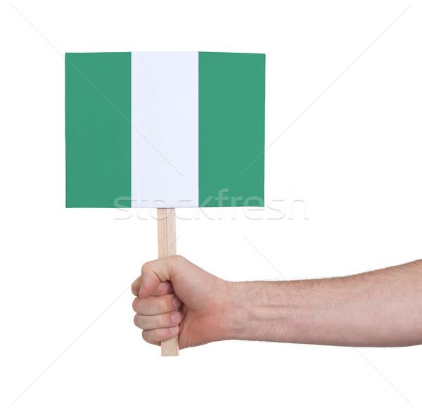 Mão pequeno cartão bandeira Nigéria Foto stock © michaklootwijk