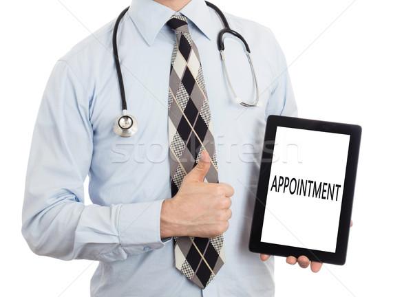 Médico tableta nombramiento aislado blanco Foto stock © michaklootwijk
