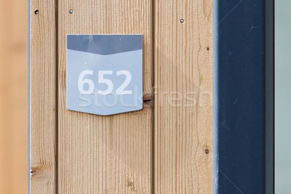 Strada numero legno bungalow casa vernice Foto d'archivio © michaklootwijk