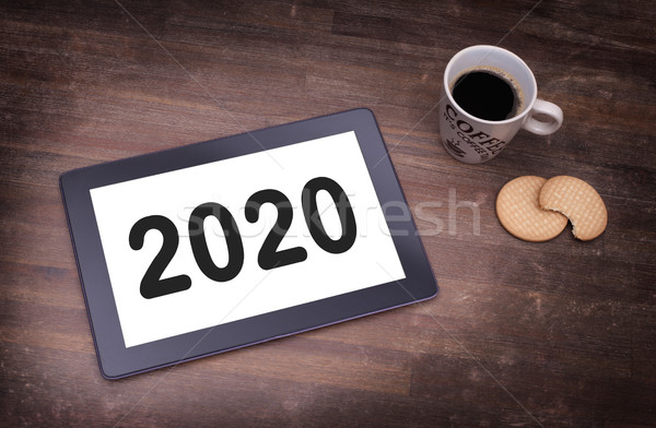 Tablet touch computer gadget on wooden table - 2020 Stock photo © michaklootwijk