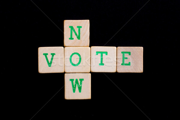 Letters on wooden blocks (now, vote) Stock photo © michaklootwijk