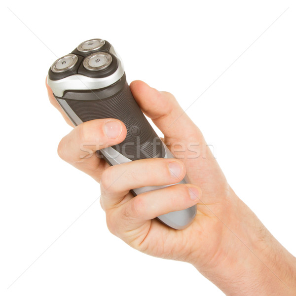 Hand holding an electric shaver  Stock photo © michaklootwijk
