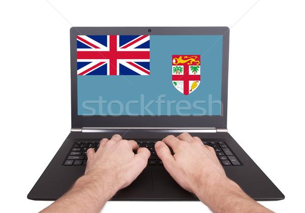 Mãos trabalhando laptop Fiji tela Foto stock © michaklootwijk