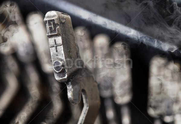 E hammer - old manual typewriter - mystery smoke Stock photo © michaklootwijk