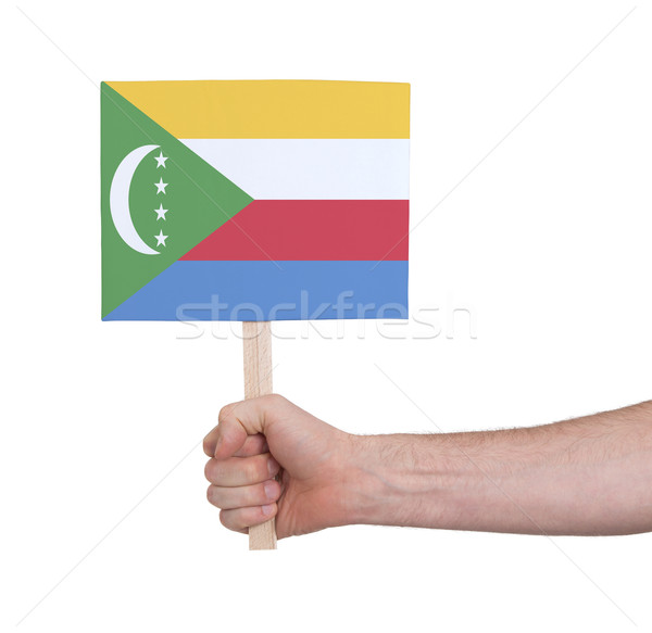 Hand holding small card - Flag of Comoros Stock photo © michaklootwijk