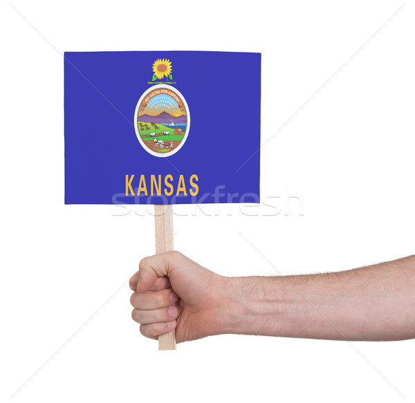 Hand holding small card - Flag of Kansas Stock photo © michaklootwijk