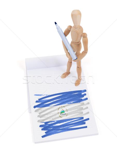 Fából készült próbababa rajz Nicaragua zászló papír Stock fotó © michaklootwijk
