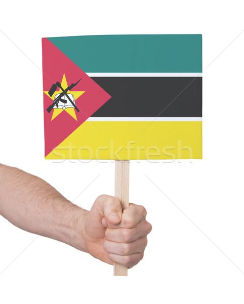 Mão pequeno cartão bandeira Moçambique Foto stock © michaklootwijk
