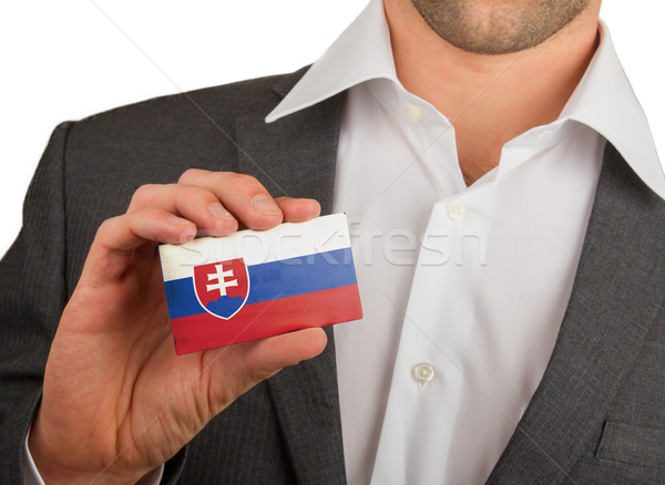 Businessman is holding a business card, Slovakia Stock photo © michaklootwijk