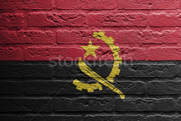 Сток-фото: кирпичная · стена · Живопись · флаг · Ангола · изолированный · кирпичных