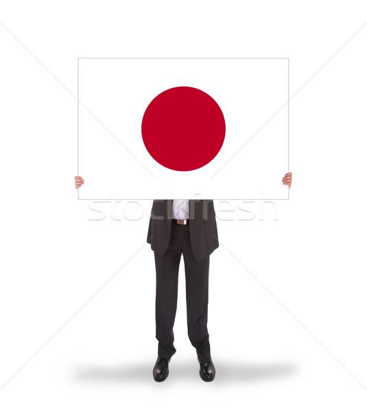 Businessman holding a big card, flag of Japan Stock photo © michaklootwijk
