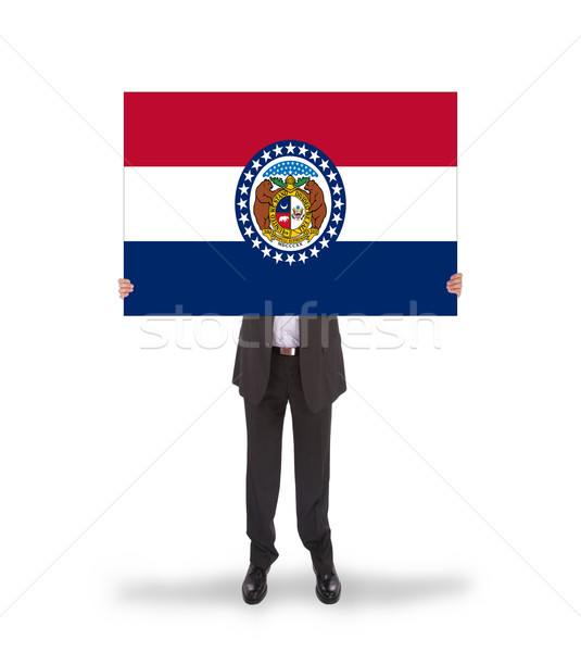 Smiling businessman holding a big card, flag of Missouri Stock photo © michaklootwijk