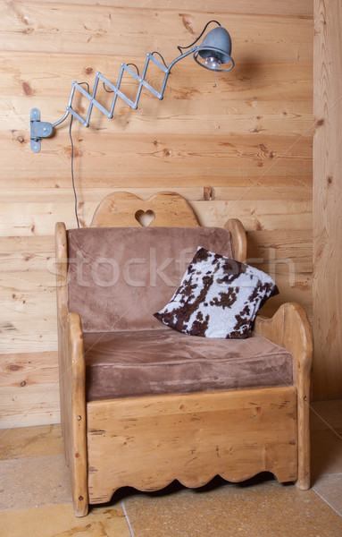 Old electric lamp and wooden chair, Switzerland Stock photo © michaklootwijk