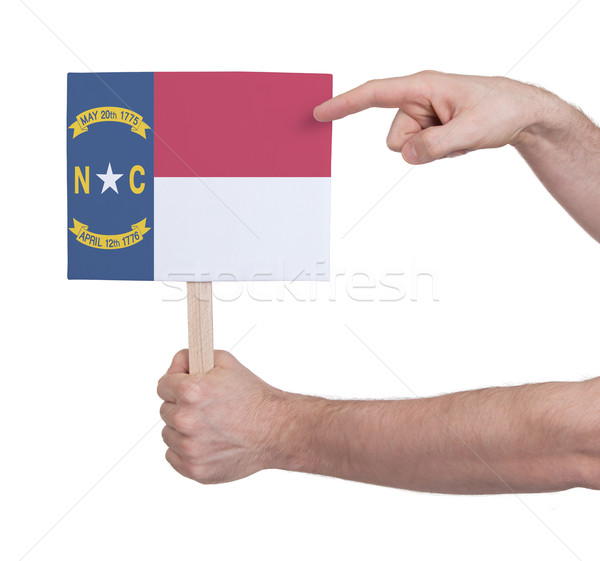 Hand holding small card - Flag of North Carolina Stock photo © michaklootwijk