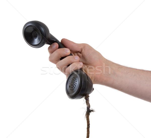 Male hand holding retro landline telephone Stock photo © michaklootwijk