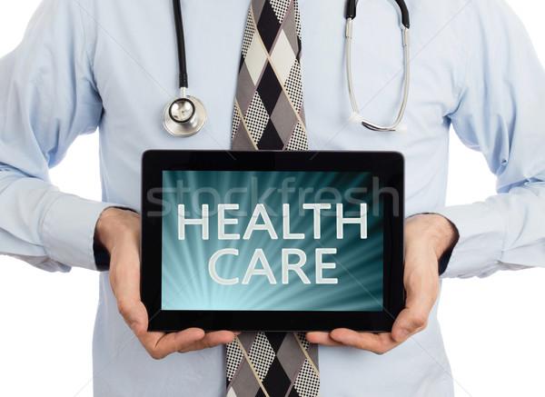 Doctor holding tablet - Healthcare Stock photo © michaklootwijk