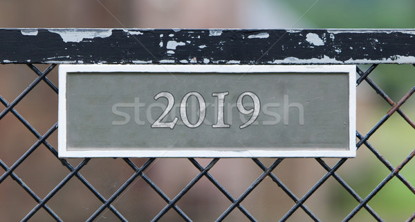 Sign on fence - 2019 Stock photo © michaklootwijk