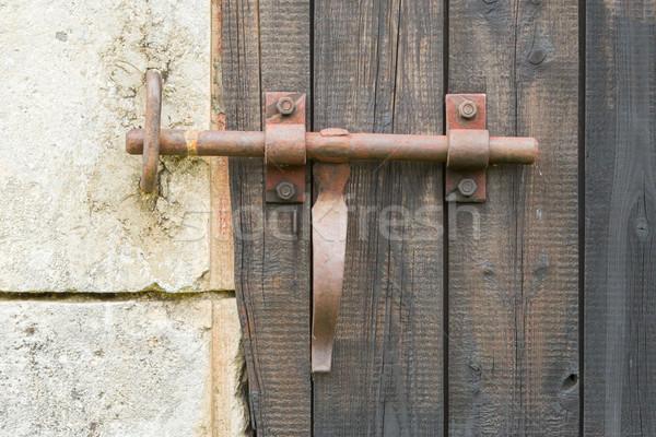 Wrought iron lock old wooden door Stock photo © michaklootwijk