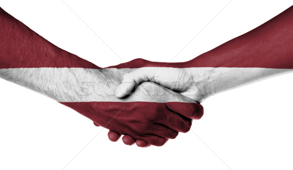 Hombre mujer apretón de manos bandera patrón Letonia Foto stock © michaklootwijk