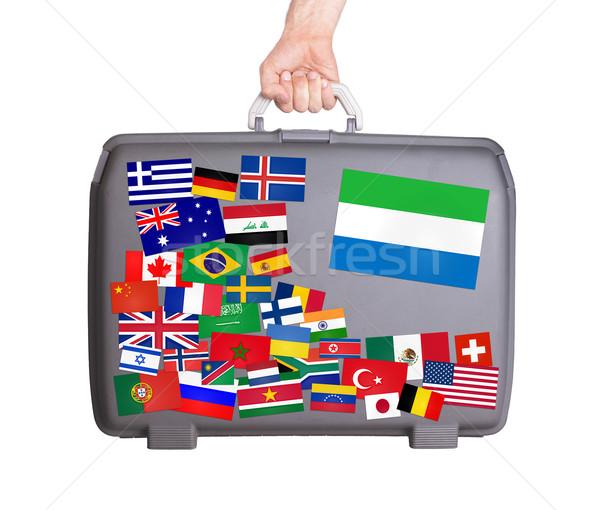 Używany plastikowe walizkę naklejki mały Zdjęcia stock © michaklootwijk