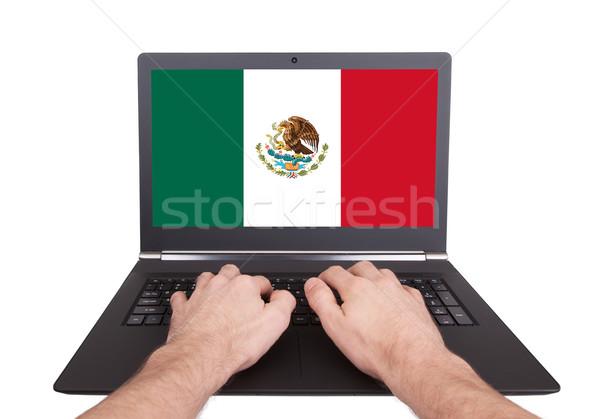 Hands working on laptop, Mexico Stock photo © michaklootwijk
