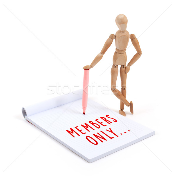 Wooden mannequin writing in scrapbook - Members only Stock photo © michaklootwijk