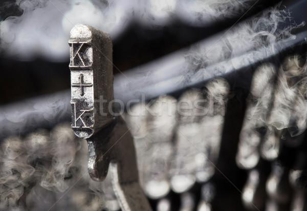 K hammer - old manual typewriter - mystery smoke Stock photo © michaklootwijk