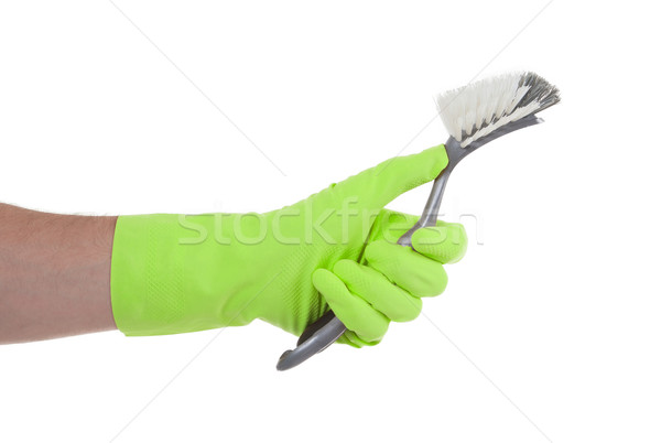 Protection glove holding a dish-brush Stock photo © michaklootwijk