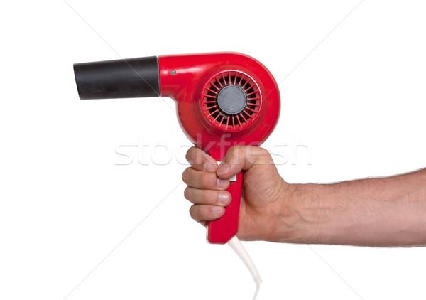 Old red hairdryer in hand Stock photo © michaklootwijk