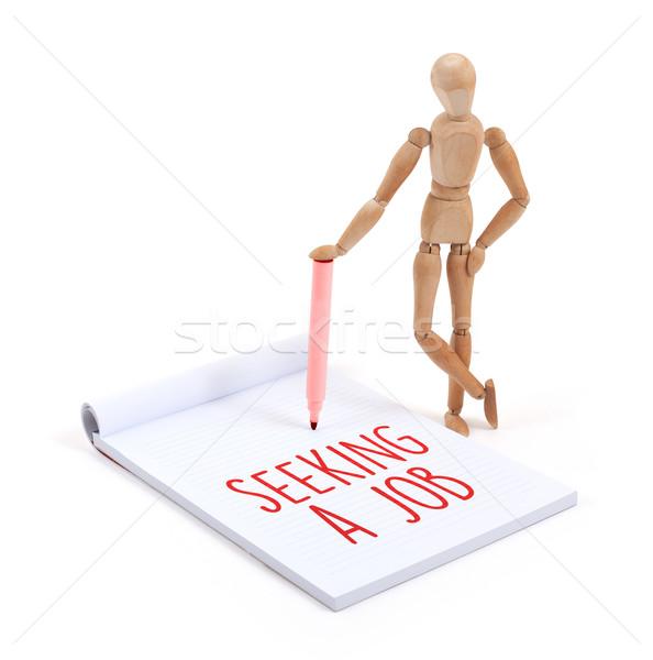 Wooden mannequin writing - Seeking a job Stock photo © michaklootwijk
