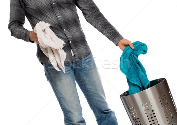 Jeune homme sale serviette panier à linge isolé vêtements Photo stock © michaklootwijk