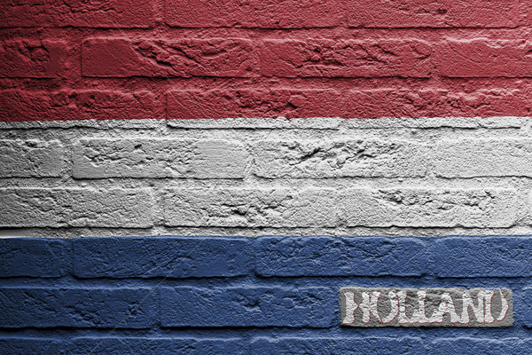 Brick wall with a painting of a flag, Holland Stock photo © michaklootwijk