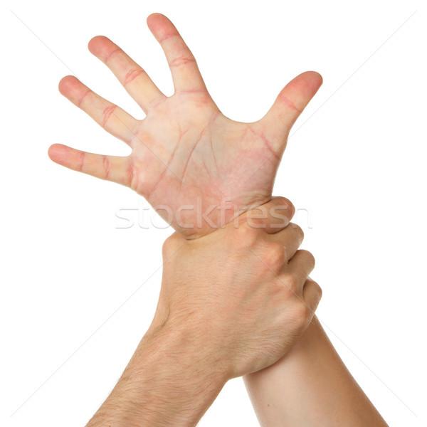 Man holding woman by wrist Stock photo © michaklootwijk