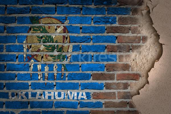Oscuro pared de ladrillo yeso Oklahoma textura bandera Foto stock © michaklootwijk