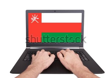 Hands working on laptop, Oman Stock photo © michaklootwijk