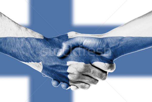 Homem mulher aperto de mãos bandeira padrão Finlândia Foto stock © michaklootwijk