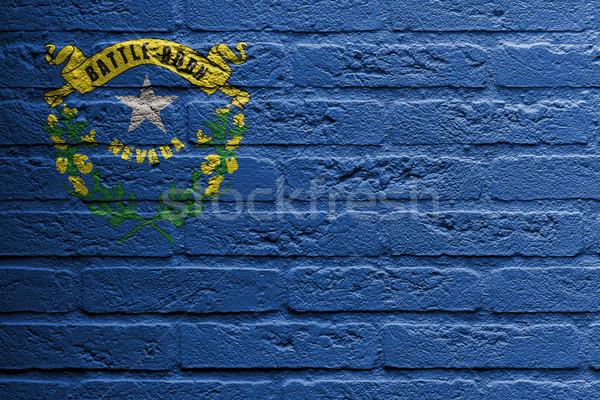 Stock fotó: Téglafal · festmény · zászló · Nevada · izolált · festék