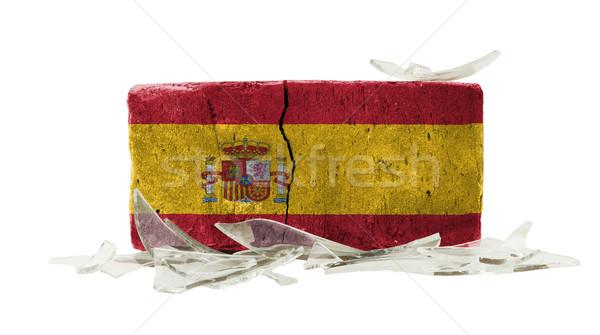 Stockfoto: Baksteen · gebroken · glas · geweld · vlag · Spanje · muur