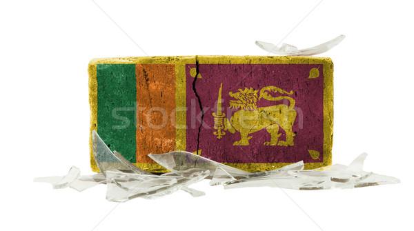 Mattone vetri rotti violenza bandiera Sri Lanka muro Foto d'archivio © michaklootwijk